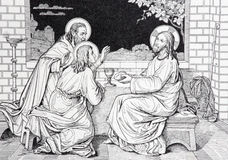 Il dîner de Jésus avec les deux disciples en lithographie d'Emmaus photographie stock