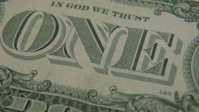Il ` del ` UNO dell'iscrizione su una fattura del un-dollaro stock footage