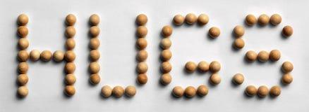 Il ` di legno di arte di parola della puntina abbraccia il ` Immagine Stock