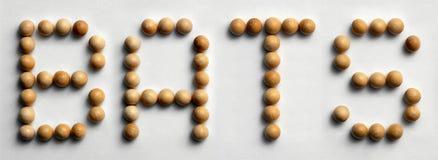 Il ` di legno di arte di parola della puntina batte il ` fotografia stock