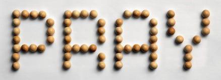 Il ` di legno di arte di parola della puntina prega il ` fotografie stock