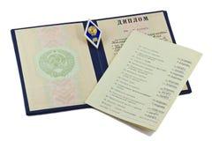 Il diploma circa l'istruzione superiore e un istituto badge fotografia stock libera da diritti