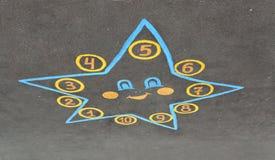 Il disegno della stella è sulla pavimentazione Fotografie Stock