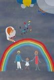 Il disegno variopinto dei bambini di una famiglia Fotografia Stock