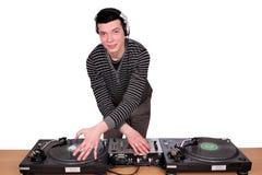 Il DJ con le piattaforme girevoli Fotografia Stock