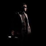 Il DJ in occhiali da sole con vinile Fotografia Stock