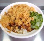 Il dolce di riso con il cetriolino ed il pesce essiccato floss il primo piano fotografia stock libera da diritti