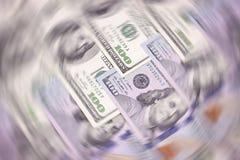 Il dollaro americano delle denominazioni differenti blured il fondo Fotografia Stock Libera da Diritti