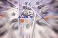 Il dollaro americano delle denominazioni differenti blured il fondo Fotografia Stock