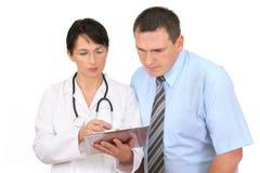 Il dottore e paziente Immagine Stock