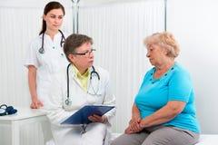 Il dottore e paziente fotografia stock libera da diritti