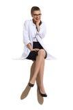 Il dottore femminile emozionante Sitting Immagine Stock