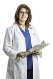 Il dottore femminile Wearing un cappotto del laboratorio Fotografia Stock