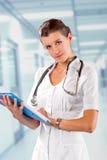 Il dottore At The Hospital della donna Immagini Stock Libere da Diritti