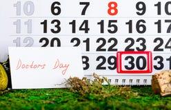 Il dottore nazionale Day di festa sul calendario Fotografie Stock