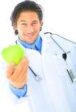 Il dottore Offering Healthy Food fotografie stock