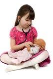 Il dottore With Stethoscope e bambola della bambina Fotografia Stock