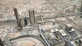 Il Dubai, UAE - 2 giugno 2013: Vista sul Dubai dall'più alta torre nel mondo, Burj Khalifa - Dubai sotto la polvere del deserto Immagini Stock