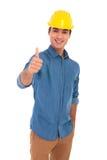 Il egineer felice della costruzione che fa l'approvazione sfoglia sul segno Fotografia Stock Libera da Diritti