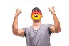Il fan bello del sostenitore dell'uomo della squadra nazionale della Germania con il fronte dipinto della bandiera ottiene la vit Immagine Stock Libera da Diritti