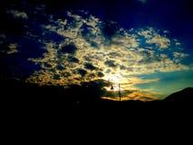 Il faro del sole all'alba fotografia stock libera da diritti