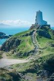 Il faro dell'isola del Mawr Llanddwyn di Twr Fotografie Stock Libere da Diritti