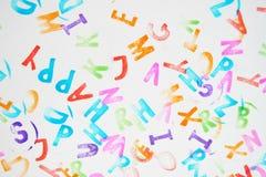 Il favorito ha colorato i bolli dell'alfabeto per i bambini su un fondo bianco Fotografie Stock Libere da Diritti