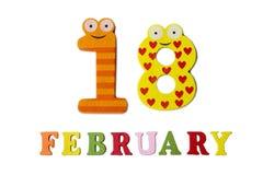 Il 18 febbraio, su un fondo bianco, sui numeri e sulle lettere Fotografia Stock
