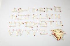 Il fiammifero segna A-Z Alphabet con lettere Fotografie Stock Libere da Diritti