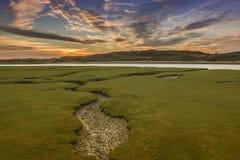 Il fiume Ogmore, Galles del sud, al tramonto Fotografia Stock