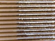 Il fondo arrugginito del metallo si è diviso in due sezioni Immagini Stock
