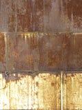Il fondo arrugginito del metallo si è diviso in tre sezioni Fotografia Stock