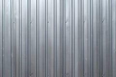 Il fondo astratto è parete d'argento della lamina di metallo Fotografia Stock Libera da Diritti
