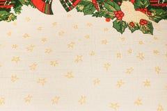 Il fondo beige del tessuto di struttura di Natale con giallo stars Immagine Stock