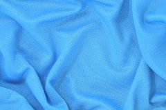 Il fondo blu di struttura del tessuto del poliestere del jersey, sport indossa il fondo fotografie stock