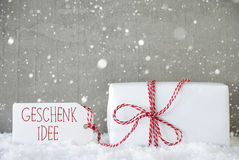 Il fondo con i fiocchi di neve, Geschenk Idee del cemento significa l'idea del regalo Immagini Stock