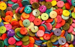 Il fondo dei bottoni misti fa con avorio vegetale Immagini Stock
