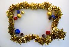 Il fondo della foto di festa con il Natale incornicia e presente Immagini Stock