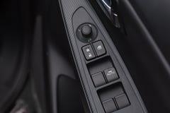 Il fondo della serratura dell'automobile/sblocca i bottoni ed i bottoni della finestra Fotografia Stock