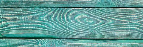 Il fondo di struttura di legno imbarca con il resto di vecchia pittura verde natalia immagine stock