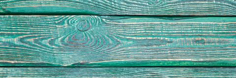 Il fondo di struttura di legno imbarca con il resto di vecchia pittura verde orizzontale natalia immagine stock libera da diritti