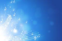 La musica nota il fondo blu Fotografia Stock