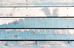 Il fondo o la struttura di legno della parete, le vecchie pareti è dipinta blu Immagine Stock
