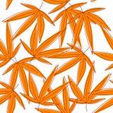 Il fondo senza cuciture con l'arancia ha appassito le foglie Fotografia Stock