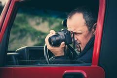 Il fotografo prende la foto Immagini Stock