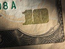 Il frammento della banconota in dollari 10 Fotografia Stock
