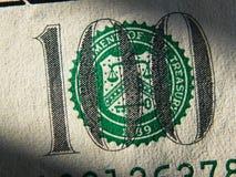 Il frammento della banconota in dollari 100 Fotografie Stock