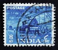 Il francobollo dell'India mostra la fabbrica del treno elettrico, circa 1930 Immagine Stock Libera da Diritti
