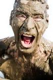 Il fronte dell'uomo è molto sporco nel fango Fotografia Stock