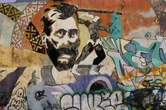 Il fronte dell'uomo dipinto sulla parete dei graffiti Fotografia Stock Libera da Diritti